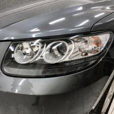 Hyundai Santa Fe (2006-2012) на Hella 3R Переходная рамка